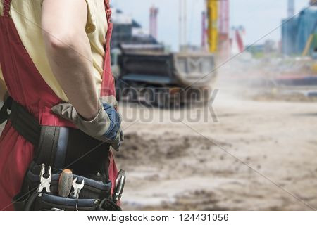 Close-up Of Builder In Uniform At Work