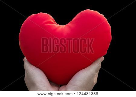 Isolated Hand Gently Hold Red Heart On Black Background (with Clipping Path)