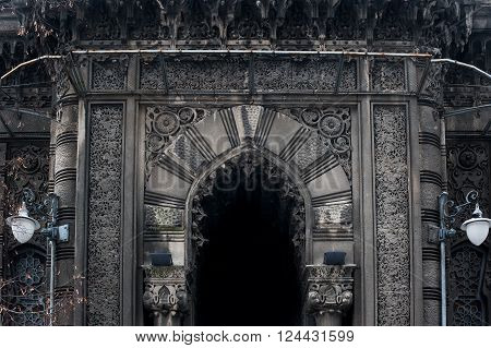 on facade of the pointed arch in Gothic style.