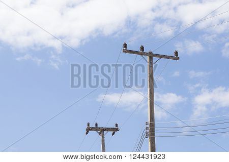 the electricity pole with the cloud sky