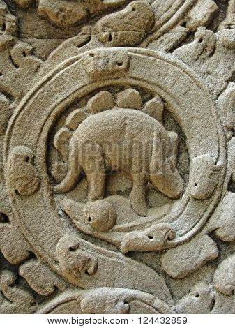 Mysterious bas relief carving depicting a dinosaur at the ancient Ta Prohm temple at Angkor Siem Reap Cambodia.