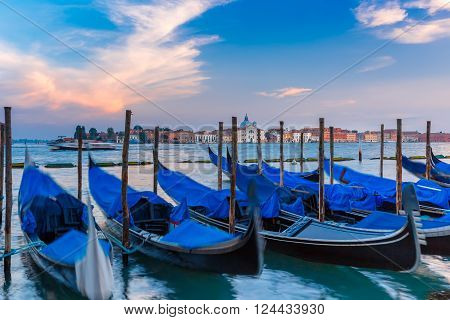 Gondolas moored by Saint Mark square in the evening, Venice lagoon, Italia
