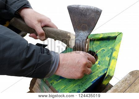 Male hand with ax and nail repairing a nesting box isolated on white shot