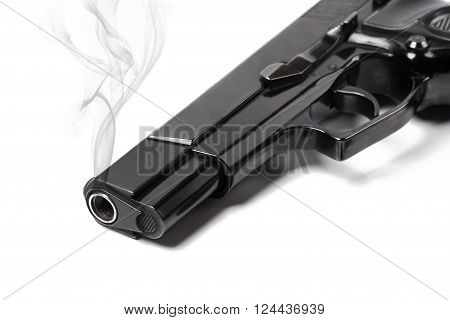Close up smoking gun on white background