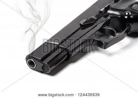 Close up smoking gun on white background