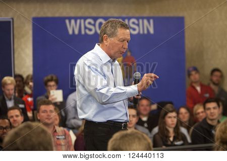 Madison Wisconsin USA - March 28 2016: Republican presidential candidate John Kasich speaks to a group of supporters during a free public town hall event before the Wisconsin presidential primary in Madison Wisconsin.