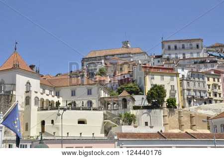 COIMBRA, PORTUGAL - AUGUST 4, 2015: People at the top of the clock of the University and other historical buildings in Coimbra Portugal