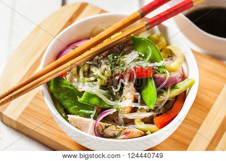Delicious asian rice glass noodles with vegetables and chicken (wok)