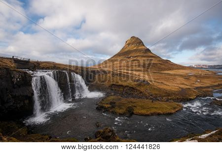 Kirkjufellsfoss waterfalls with the Kirkjufell mountain at Grundarfjordur on the Snaefellsnes peninsula in Iceland.