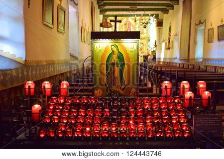 March 28, 2016 in San Juan Capistrano, CA:  Candle lit altar inside a cathedral taken at the Historic Mission San Juan Capistrano in San Juan Capistrano, CA