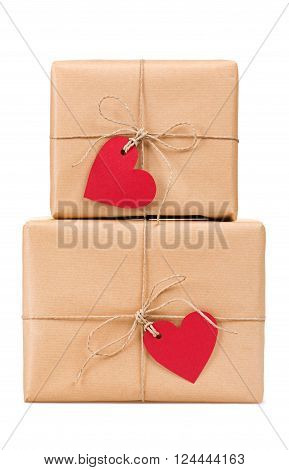 Stacked gift boxes with blank heart-shaped labels isolated on white