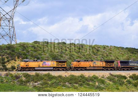 March 29, 2016 in Cajon, CA:  Union Pacific train transporting commerce southbound towards Los Angeles and to the Port of Los Angeles where goods will be exported on freighter ships taken in Cajon, CA