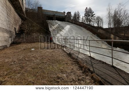 IVANGOROD, LENINGRAD OBLAST, RUSSIA - MARCH 29, 2016: Flood water discharge at Narvskaya Hydroelectric Power Plant. Built in 1956 at the border between Russia and Estonia, it has capacity 125 MW