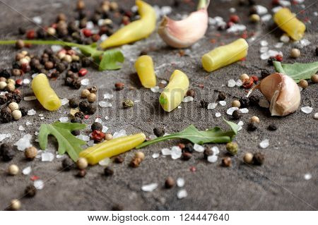 Food ingredients on a background.  Sea Salt and Pepper granules and yellow string beans