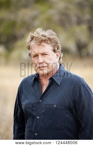 BEAUFORT, SOUTH CAROLINA-JANUARY 21, 2012: Portrait of Hollywood actor Tom Berenger taken in outdoor setting.