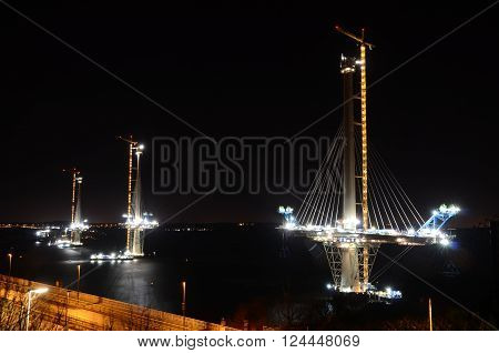 A night time view of the construction of the new Forth bridge