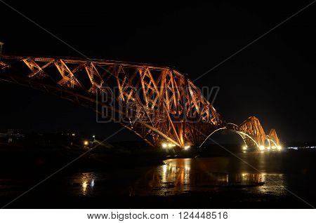 A view of the iconic Forth rail bridge at night