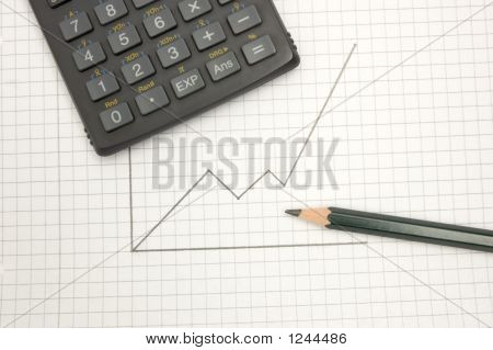 Calculator And Pencil On Sqared Paper