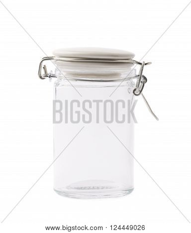 Empty glass jar with the ceramic cap hold with metal wire, isolated over the white background