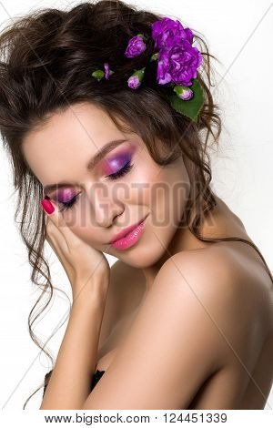 Portrait of young beautiful female holding touching her face. Bright spring or summer modern fashion make up. Pink lips and smokey eyes. Skin treatment or natural cosmetics concept