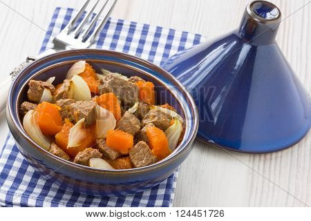 Delicious beef stew with pumpkin and onion in tajine pot
