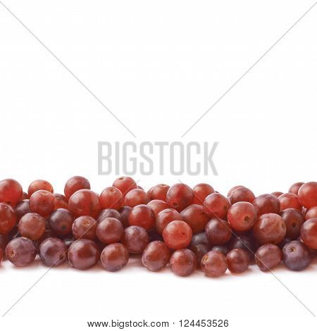 Copyspace background composition with the borders made of the dark red grapes isolated over the white background