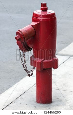 red fire hydrant on a city street
