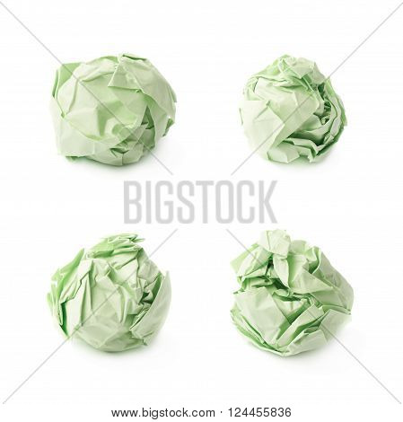 Crumple green paper ball isolated over the white background, set of four foreshortenings