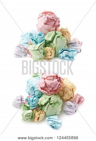 Pile of multiple colorful crumpled paper balls isolated over the white background, set of two different foreshortenings