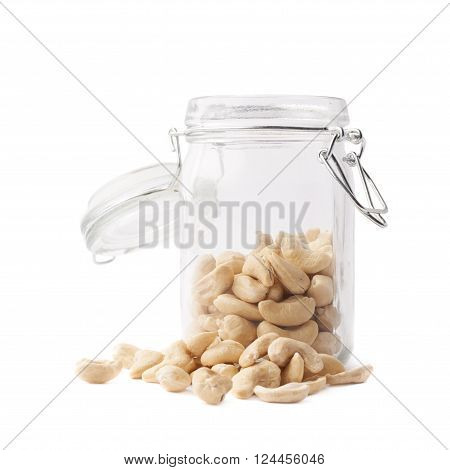 Glass jar filled with the cashew nuts isolated over the white background