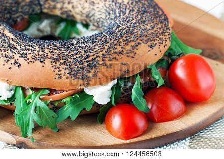 Bagels with arugula , smoked fish and cream cheese