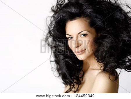 Pretty woman with volume curly black hair