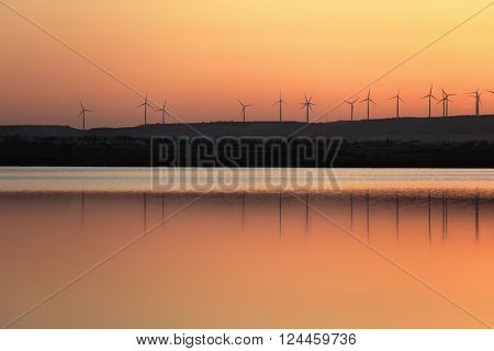 Sunset over the wind farm at Salt lake in Larnaca, Cyprus