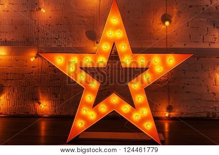 golden star with light bulbs