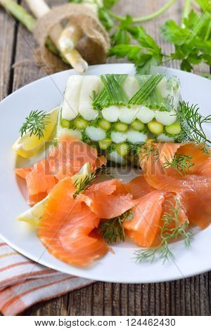 Asparagus jelly with fresh white and green asparagus and chives, served with delicious smoked salmon