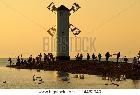 Swinoujscie, Poland - August 20, 2009 Tourists on the breakwater in Swinoujscie during holiday relaxation.