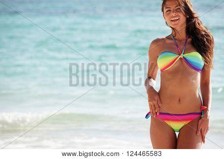 Beautiful happy woman in bikni on tropical beach