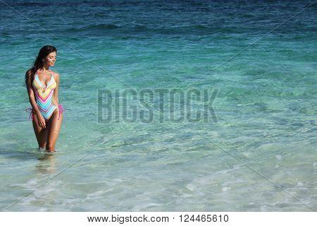 Beautiful woman in swimwear in tropical sea