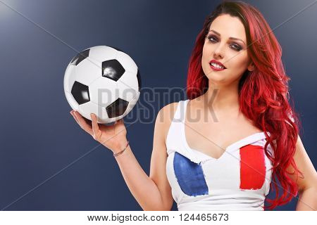 Picture of sexy woman wearing french flag and holding football