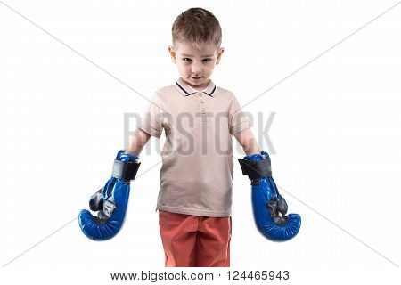 Cute little boy with boxing gloves on white background