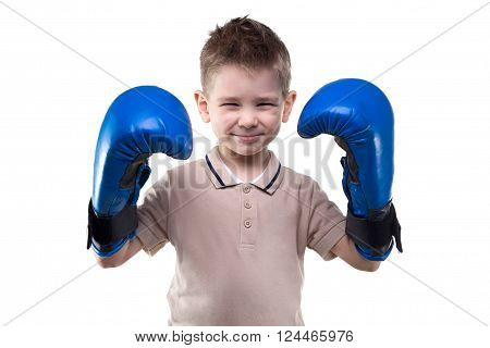 Cute smiling little boy with boxing gloves on white background