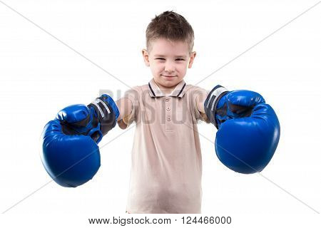 Smiling little boy and boxing gloves on white background