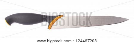 Steel kitchen knife with the black and orange handle isolated over the white background