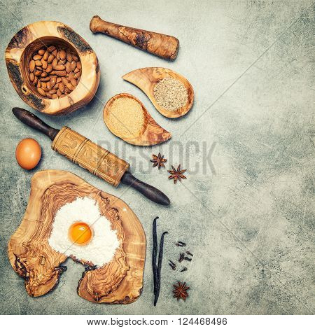 Baking ingredients and spices. Flour eggs sugar almonds vanilla. Vintage style toned picture