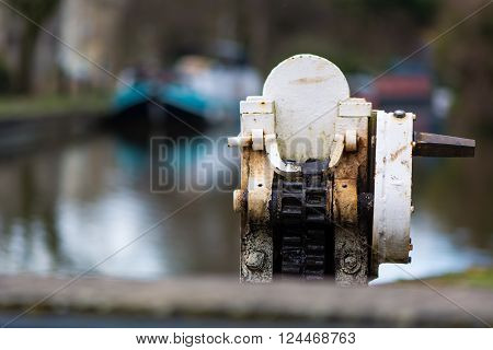Gear mechanism for canal lock. A mechanism for opening a lock gate on the Kennet and Avon canal, with narrow boats in background