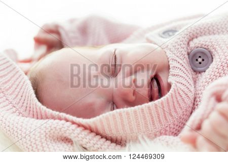 Newborn baby crying, scream face expression. White background