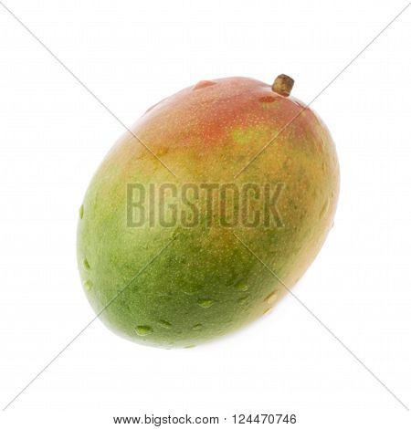 Single ripe mango fruit covered with water drops isolated over the white background
