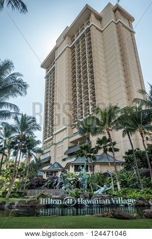 Waikiki, Honolulu, Hawaii, USA - December 13, 2015: One of the many areas of the huge Hilton Hawaiian Village Resort complex. This area is on the corner of Ala Moana Boulevard and Kalia Road
