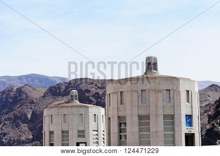 View of the penstock towers over Lake Mead at Hoover Dam, between Arizona and Nevada states, USA.
