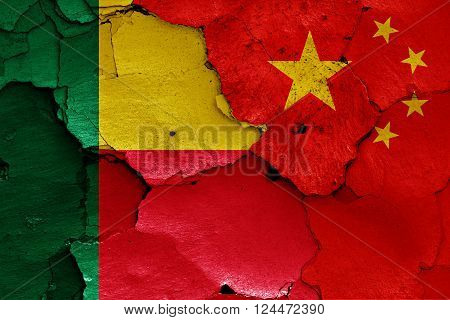 flags of Benin and China painted on cracked wall